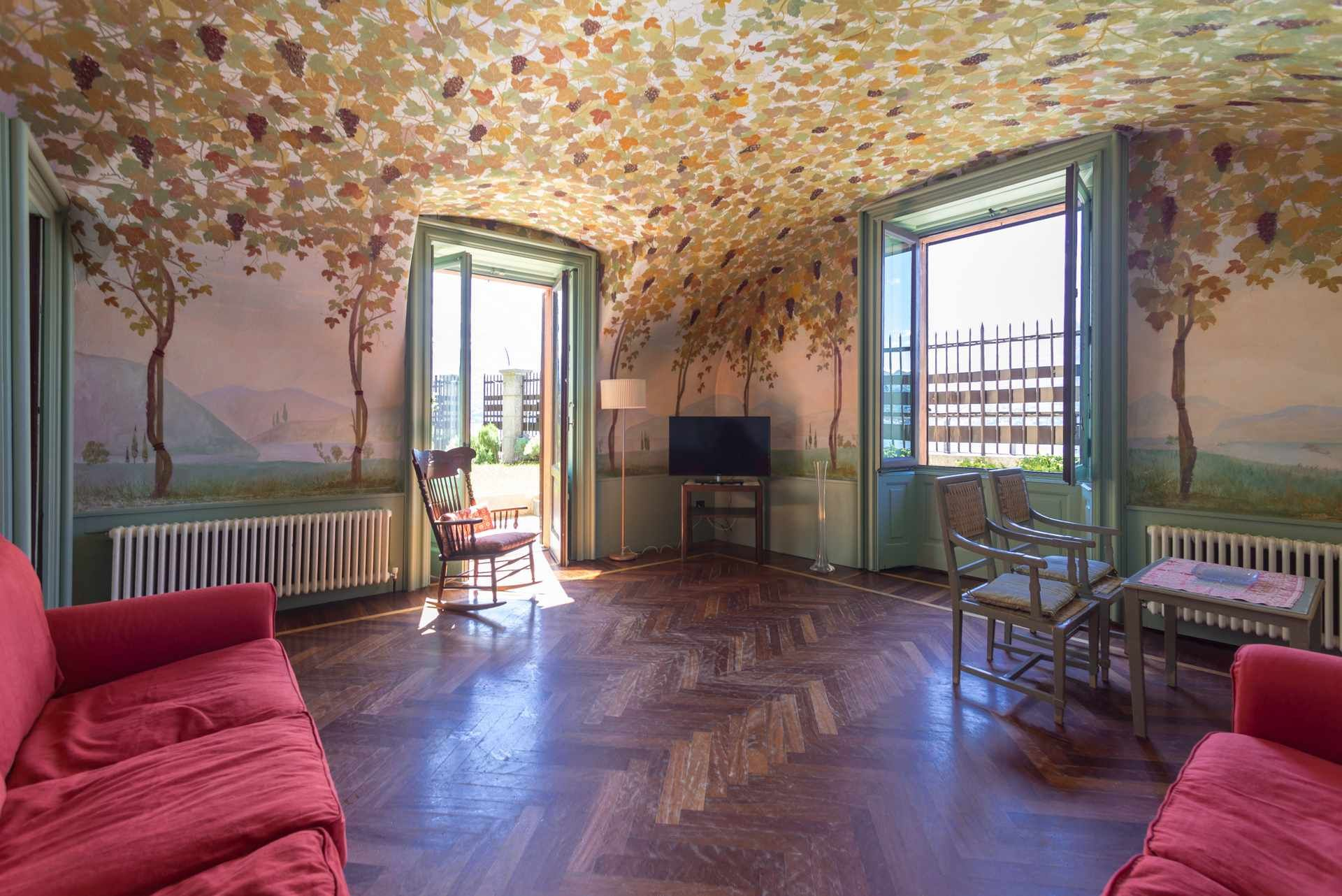 Let yourself be surprised by its frescoed rooms